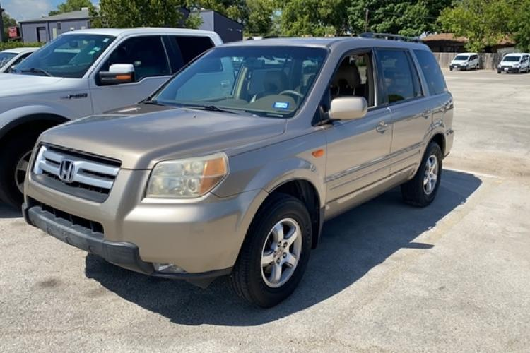 2007 Tan Honda Pilot EX-L 2WD (5FNYF28577B) with an 3.5L V6 SOHC 24V engine, 5-Speed Automatic Overdrive transmission, located at 5005 Telephone Rd., Houston, TX, 77087, (713) 641-0980, 29.690666, -95.298683 - Photo #0