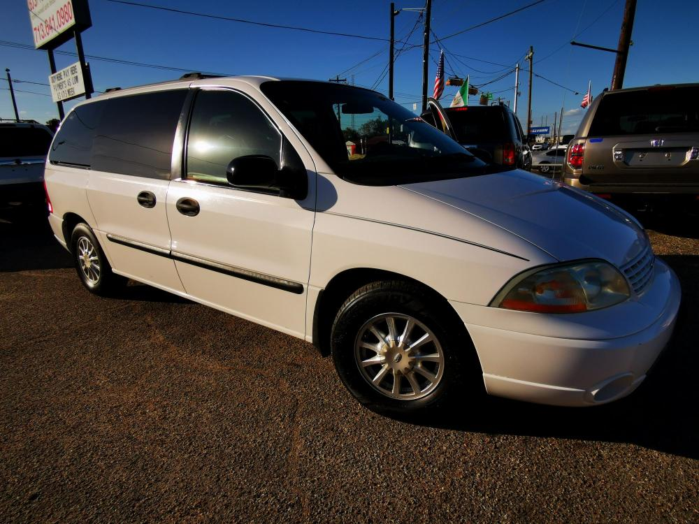 2002 Ford Windstar LX (2FMZA51402B) with an 3.8L V6 OHV 12V engine, 4-Speed Automatic Overdrive transmission, located at 5005 Telephone Rd., Houston, TX, 77087, (713) 641-0980, 29.690666, -95.298683 - Photo #0